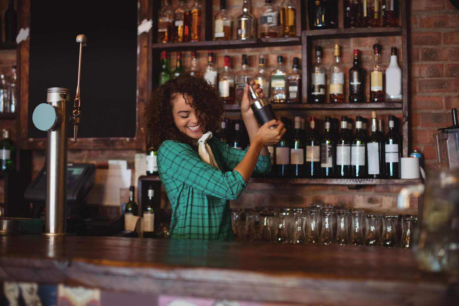 female-bartender-mixing-cocktail