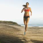 USA,-California,-San-Diego,-Woman-training-on-coast
