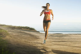 USA,-California,-San-Diego,-Woman-training-on-coast