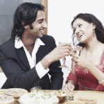 Young-couple-toasting-with-wineglass-at-the-dining-table